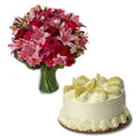 Captivating Gift of Lilies and Red Roses Bouquet with Lemon Cake